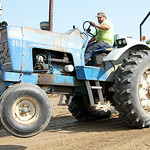 Scott Norton pulls his Ford 8600 tractor 266 feet in class C of the Lorain County Fair county tractor pull. ANNA NORRIS/CHRONICLE
