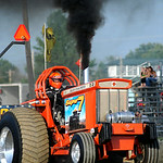 Steve Ruffing, of Bellevue, competes in the Tractor Pull at the Lorain County Fair on Aug. 22. KRISTIN BAUER | CHRONICLE