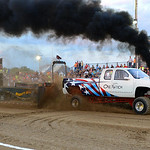 Eric McConnell drive his truck, One Nation, during the Smokeout Race on Aug. 20. KRISTIN BAUER | CHRONICLE