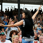 Fans cheer as Foreigner lead singer Kelly Hansen runs into the crowd during the band's concert at the Lorain County Fair on Tuesday evening. KRISTIN BAUER/CHRONICLE