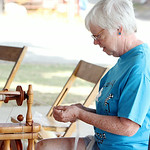 Ann Hauser, of Pittsfield, spins wool into yarn during the Lorain County Spinners and Weavers Guild demonstration at the Lorain County Fair Sunday afternoon. Hauser has been spinning yarn fo …