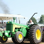 The front wheels come up on Jim Knapp's John Deere 830 tractor as he competes in class C of the Lorain County Fair county tractor pull Saturday morning. ANNA NORRIS/CHRONICLE