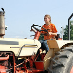 Sarah Hricovec, of Avon, pulls the tractor in class B of the Lorain County Fair county tractor pull Saturday morning. ANNA NORRIS/CHRONICLE