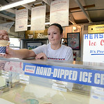 Holly Chalkwater, of North Ridgeville, serves ice cream to customers at the Hershey's booth Tuesday evening. KRISTIN BAUER | CHRONICLE
