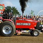 Andrew Trowbridge, of South Haven, Mich., competes in the Tractor Pull. KRISTIN BAUER | CHRONICLE
