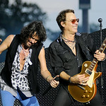Foreigner lead singer Kelly Hansen and guitarist Mick Jones sing together during their concert on Tuesday. KRISTIN BAUER | CHRONICLE