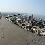The Memphis Belle flies over downtown Cleveland on Monday. BRUCE BISHOP/CHRONICLE