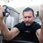 Robert Wisniewski, of Vermilion, works out on the arm curl machine at the Wellness and Fitness Center Open House at Mercy Regional Medical Center in Lorain on Apr. 7. The open house showcas …