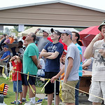 People of all ages look to the sky as members of the Lorain County Radio Control Club fly their model airplanes during the annual Model Mania show at Crawford Field in Elyria Sunday afternoo …