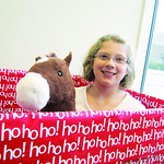 Nicole, 10, horses around in the toy box after donating to Not Forgotten Box.