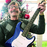 Greg French of Frenchies Guitars & More on East Avenue in Elyria donated a Squire Stratocaster electric guitar and case.