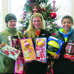 Sharon Yunt, Kaylyn McKern and Mykal Bowens of Elyria donated toys Saturday.
