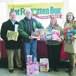 Lake Erie Landlord Association employees Lance Schuerger, left, Alex Heyd, Kathy Machado and Marija Georgievski are shown with only a few of the many toys they donated this year.