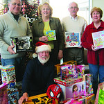 Elyria Sunrise Rotary donated more than 60 toys and $50. Pictured are John Bryan, left, Jill Petitti, Paul Campagna and Joan Villarreal.