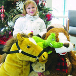 Giavanna Trombette, 7, of Columbus, donated toys while she was in town visiting her grandma and dad.