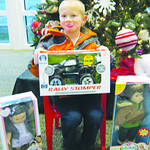 The Reitz family of Elyria has been longtime donors of the Not Forgotten Box. Here, Anthony Reitz, 5, poses with some of the family's contributions.