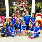 Girl Scout Troup 50128 from St. Jude first grade came to the Chronicle-Telegram for a tour on Dec. 4 and wanted to donate toys to the Not Forgotten Box. Pictured are back row: Alesha, Melody …