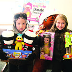 Ethan Twining, 5, and Allison Twining, 8, of Elyria, donated toys.