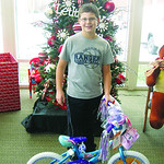 Owen Dougan represented Wesleyan Village, which donated a bike and helmet.