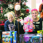 Laila, left, and her sister, Lilly, have been offering food and water for donations at Vermilion's Wooly Bear Parade for the past three years. All proceeds go to buy toys for The Not Forgo …