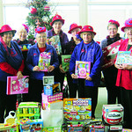 The Red Hats of French Creek enjoyed shopping for The Chronicle's Not Forgotten Box. Pictured in the back row are Dianne Fischer, left, Tony Caldwell (vice queen), Rose Ann Urbanic and Gin …