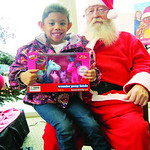 Emmaline, 5, of Elyria, poses with Santa while donating to the Not Forgotten Box.