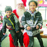 Zaedin and his sister, Kylin Fenderson, of Elyria, pose with Santa.