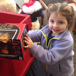 Jillian Markowich, 4, puts a toy in the Not Forgotten Box.