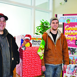Nate Miller, left, and Kevin Stewart from Stewart Appliance deliver toys the store collected for The Not Forgotten Box.