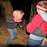 10/17/09 Novotny Farm Market Rt 60 Vermilion, Ohio Holowen Corn Maze. These girls have just been surprised by one of the haunts on the half mile corn Maze walk.  At right in red is Ashlynn Y …