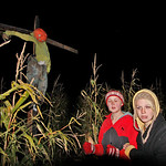 10/17/09 Novotny Farm Market Rt 60 Vermilion, Ohio Holowen Corn Maze. At right in yellow hood is Becca Mowel of Clyde.  At right in red is Ashlynn Yost also of Wakeman. Photo by Tom  Mahl