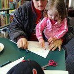 "Tony Hazelett of Elyria makes a pennant with his daughter Payton, 2, at ""Opening Day"" event at the Elyria Central Branch Library on Washington Ave. on Mar.31. Kids and parents made pennants …"