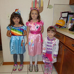 Sisters Isabelle, 6, as Rainbow Dash; Lizzy, 8, as Pinkie Pie; and Evelyn, 3, as Doc McStuffins, are ready for Halloween.