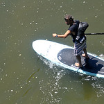 Paddleboarder Jim Lawhead makes his way down the French Creek Saturday afternoon as part of the Black River Kayak-a-thon. While other participants opted to enter the kayak and canoe races, L …