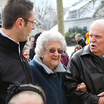 Principal Joe Akosi (left) and Wendell Strunk (right) escort Elsie McKinnon who graduated from St. Anthony in 1935 and will cut the ribbon over the doors at the restored school in Lorain. ph …