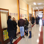 The main hallway of St. Anthony's in Lorain has a bright new floor and ceiling as parents and students visit with teachers in the restored school. photo by Ray Riedel