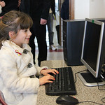 Second grader Autumn Schmotzer, age 7, checks out the computer in the restored computer classroom at St. Anthony's School in Lorain. photo by Ray Riedel