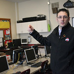 Principal Joe Akosi in the computer room at St. Anthony's School, describes how the computers and smartboard were saved from the damage from the storm, but the floor, carpeting and ceiling h …