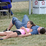 A long International Festival left plenty of folks in need of a nap. Catching a quick one Sunday afternoon at the festival bazaar were Cassie Bernacik of Grafton and her boyfriend, Ed Mangin …