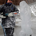 Aaron Costic, of Elegant Ice Creations in Broadview Hts., works on a sculpture at the Vermilion Ice-A-Fair Feb. 5. Steve Manheim