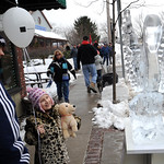Shane Canterbury and daughter Kyleigh, 7, of Vermilion, look over a swan ice sculpture on Main St. at the Ice-A-Fair in Vermilion Feb. 5. Steve Manheim