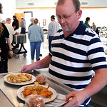 Ray Fitzwater of Sheffield serves fish dinners at the second annual St. Teresa of Avila fish fry during lent on Feb. 19.  The church will continue to serve on Friday's through Good Friday on …