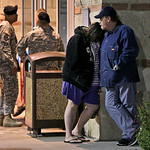 U.S. Army soldiers are seen at rear as Jamie Casteel, left, front, and her husband Scotty, right, of Duncan, Okla., stand outside the emergency room at Scott & White hospital in Temple, Texa …