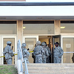 Soldiers move into the Soldier Readiness Center on Fort Hood as they secure the area where Maj. XX shot and killed 12 soldiers and wounded 31 others during a shooting spree that took over 7  …