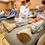 Phlebotomist Sumer Mosley, second from right, takes a blood donation from U.S. Army Pfc. Jose Estrada, with the 411th Military Police Company at Fort Hood, Thursday, Nov. 5, 2009, at Scott a …