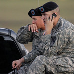 Spc. Ryan Howard of Niles, Mich., right and Spc. David Straub of Ardmore, Okla. wait for news of fellow soldiers while waiting at the gate of the Army base after a shooting at Fort Hood, Tex …