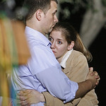 Daniel Clark comforts his wife Rachel Clark at the main gate in Fort Hood, Texas on Thursday, Nov. 5, 2009. US Army Maj. Nidal Malik Hasan opened fire on fellow soldiers at the Fort Hood mil …