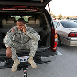 Spc. Michael Fairman makes phone calls from the back of his car outside a gate at the base in Fort Hood, Texas to find about son following a shooting at Fort Hood, Thursday, Nov. 5, 2009. (A …
