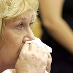 Beverley Clark wipes away tears following a prayer for the victims of a  shooting at the Army base Fort Hood as she watches television for updates at the Survivor Outreach Services building  …