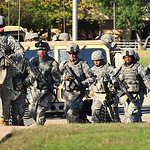 Soldiers from the 3rd Armored Cavalry Regiment storm the grounds of the Soldier Readiness Center in a show of force as they help in the apprehension of Maj. Nidal Malik Hasan Thursday Nov. 5 …
